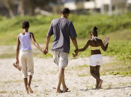 obama and daughters malia and sasha walk on kailua beach hawaii